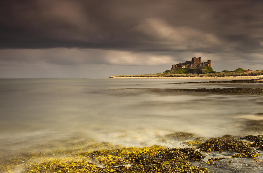 Bamburgh Castle Under A Cloudy Sky Photograph