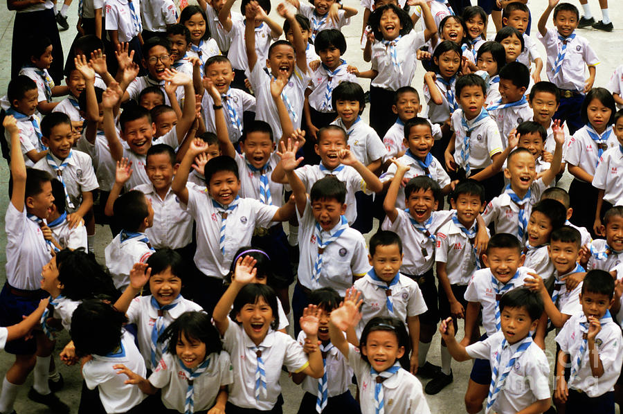 Bangkok School Children Jumping And Smiling At The Camera Photograph  - Bangkok School Children Jumping And Smiling At The Camera Fine Art Print