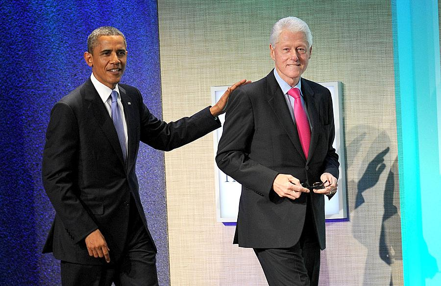 Barack Obama, Bill Clinton At A Public Photograph