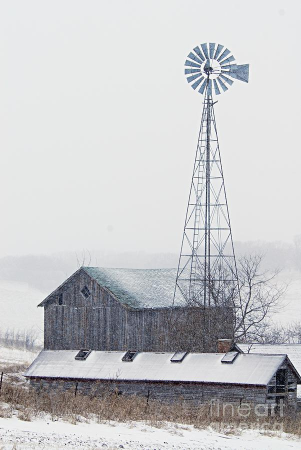 Barn And Windmill In Snow Photograph