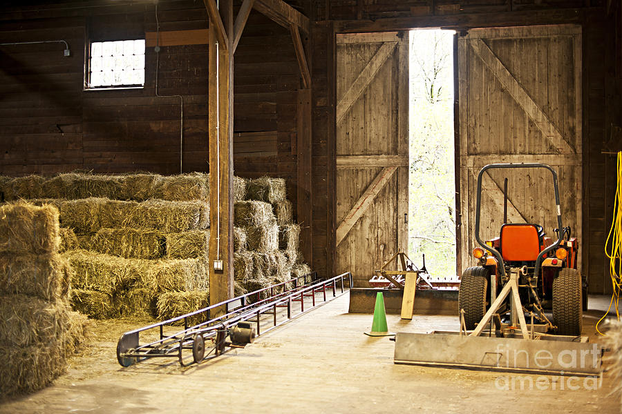 Barn With Hay Bales And Farm Equipment Photograph