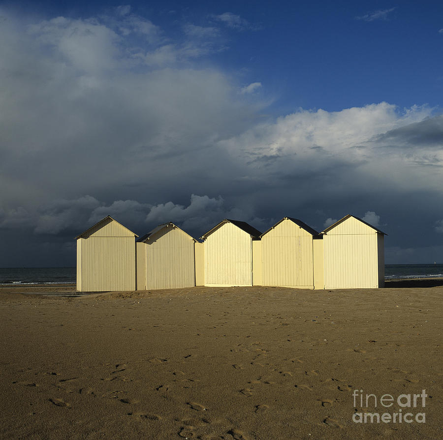 Beach Huts Under A Stormy Sky In Normandy Photograph  - Beach Huts Under A Stormy Sky In Normandy Fine Art Print