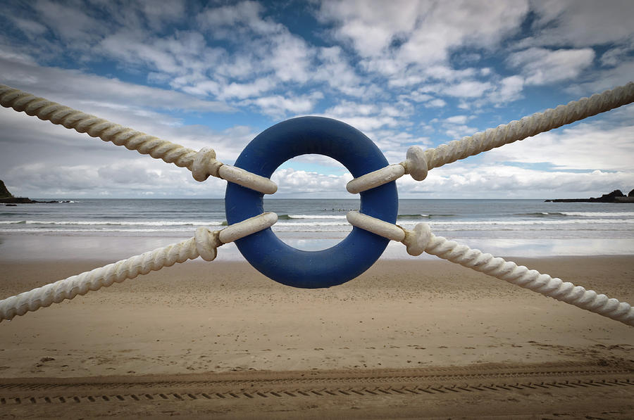 Beach Through Lifeguard Tied With Ropes Photograph