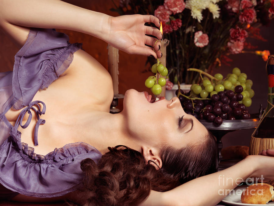 Beautiful Woman Eating Grapes On A Festive Table Photograph  - Beautiful Woman Eating Grapes On A Festive Table Fine Art Print