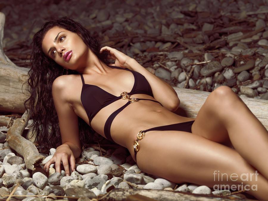Beautiful Young Woman in Black Bikini on a Pebble Beach Photograph ...