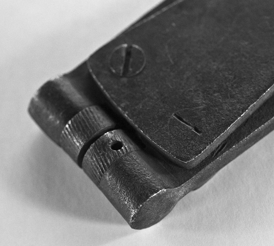 Black And White Handheld Holepunch Photograph