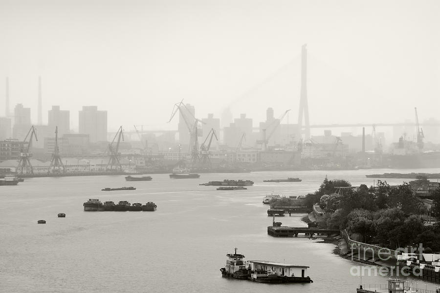 Black And White Of Cranes And River Traffic Photograph