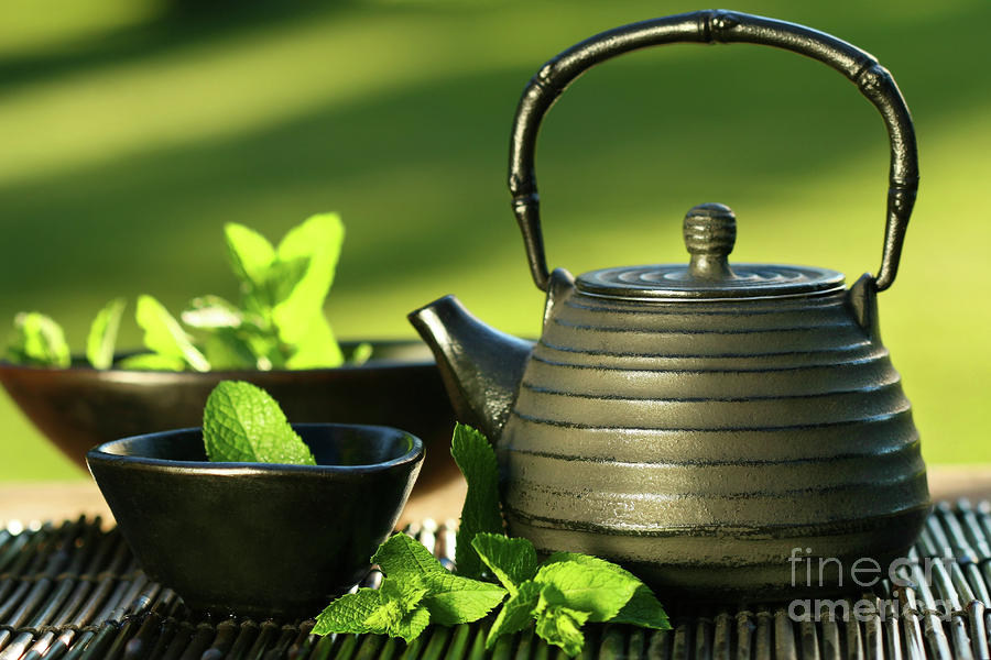 Black Asian Teapot With Mint Tea Photograph