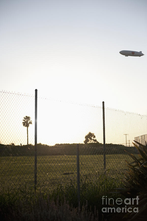Blimp Flying Over Sports Field Photograph