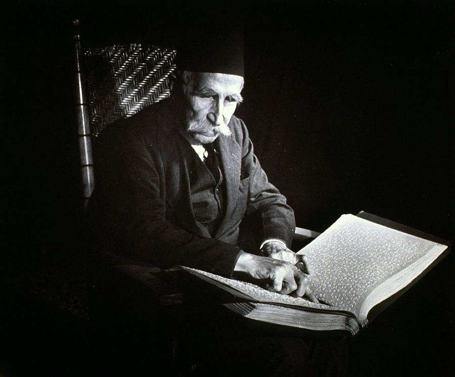 Blind Man Reading A Braille Book, Ca Photograph