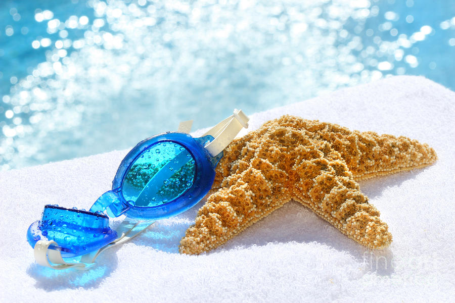Blue Goggles On A White Towel  Photograph