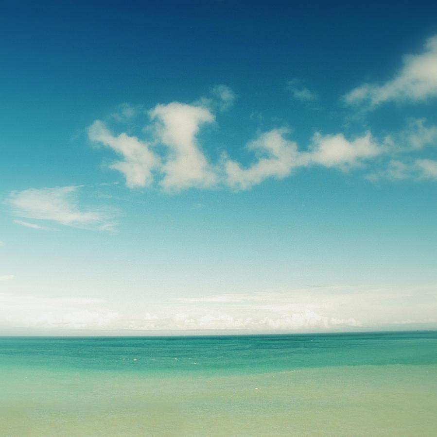 Blue Sky Over Ocean Photograph