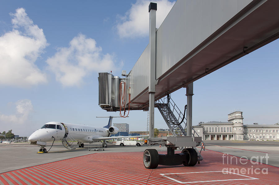 Air Travel Photograph - Boarding Bridge Leading To A Parked Plane by Jaak Nilson