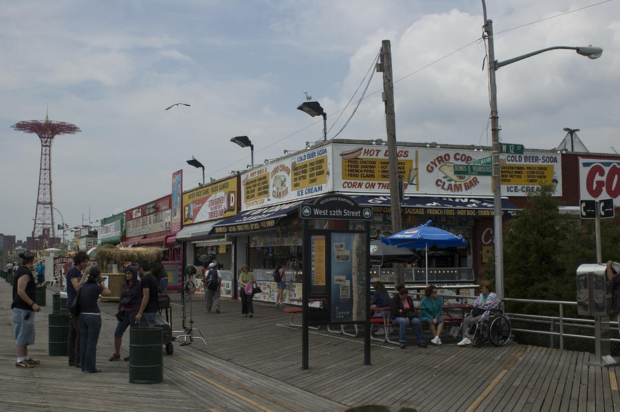 Local Landmark Photograph - Boardwalk At Coney Island On A Cloudy by Todd Gipstein
