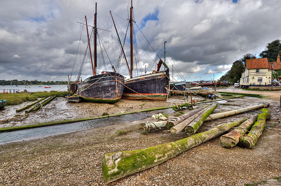 Boats And Logs At Pin Mill Photograph