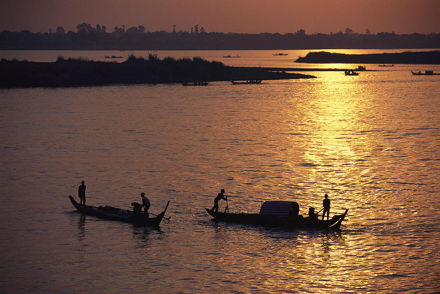 Boats Silhouetted On The Mekong River Photograph  - Boats Silhouetted On The Mekong River Fine Art Print
