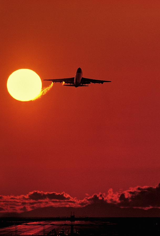 Boeing 747 Taking Off At Sunset Photograph