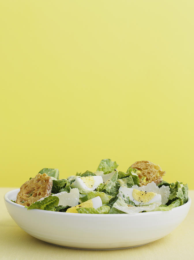 Bowl Of Caesar Salad With Egg Photograph