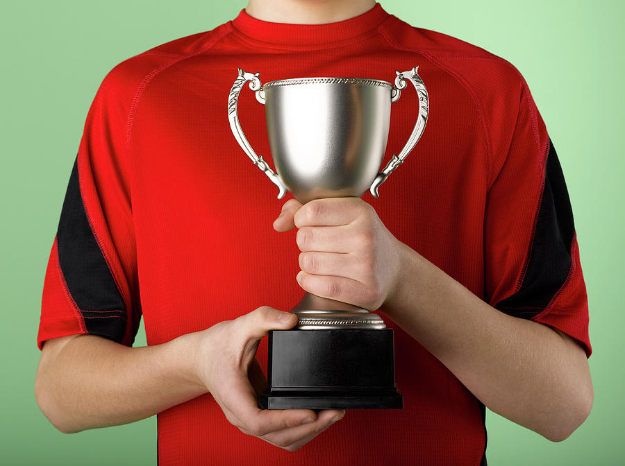 Boy Holding Trophy Photograph