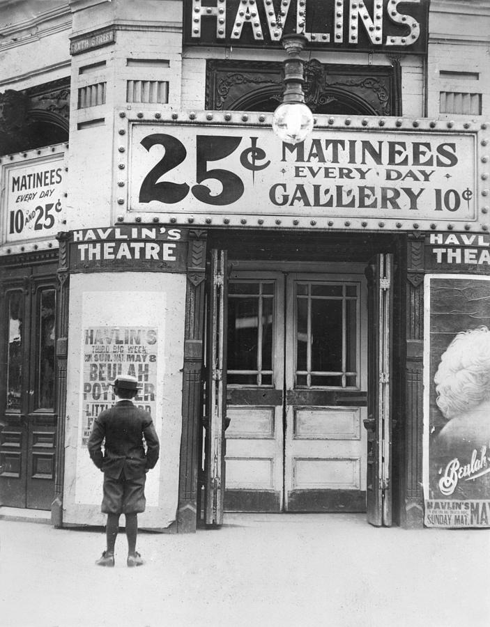 Boy In Front Of A Movie Theater Showing Photograph  - Boy In Front Of A Movie Theater Showing Fine Art Print