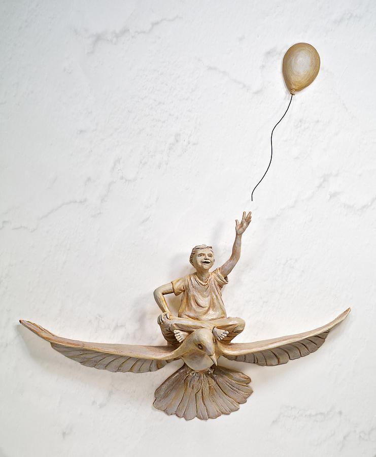 Boy In Pursuit Sculpture
