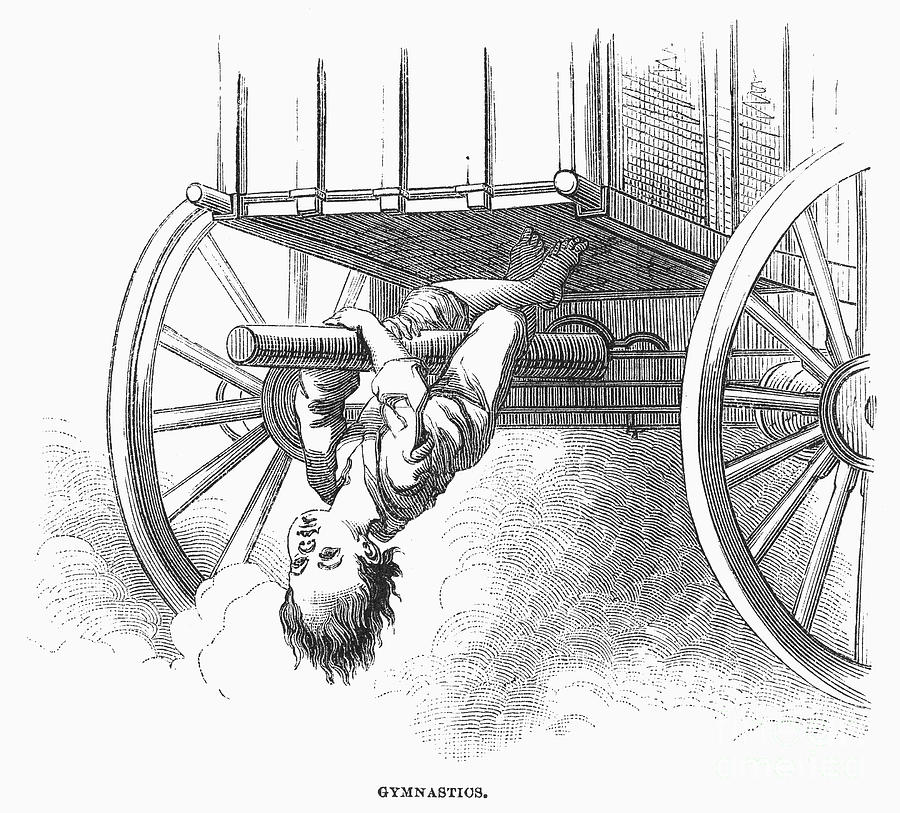 Boy Riding Under Wagon Photograph