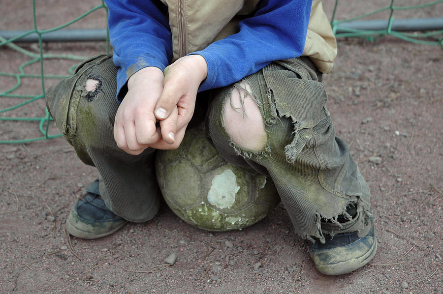 Boy Sitting On Ball - Torn Trousers Photograph  - Boy Sitting On Ball - Torn Trousers Fine Art Print