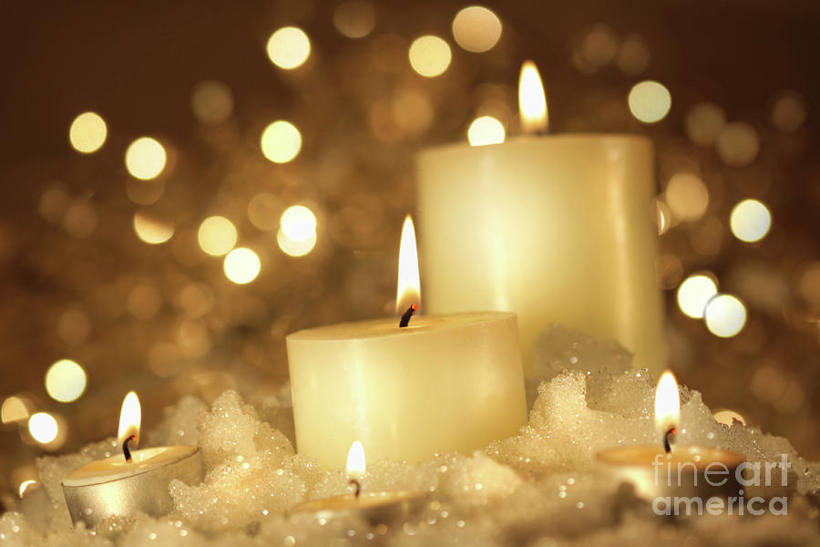 Brightly Lit Candles In Wet Snow Photograph