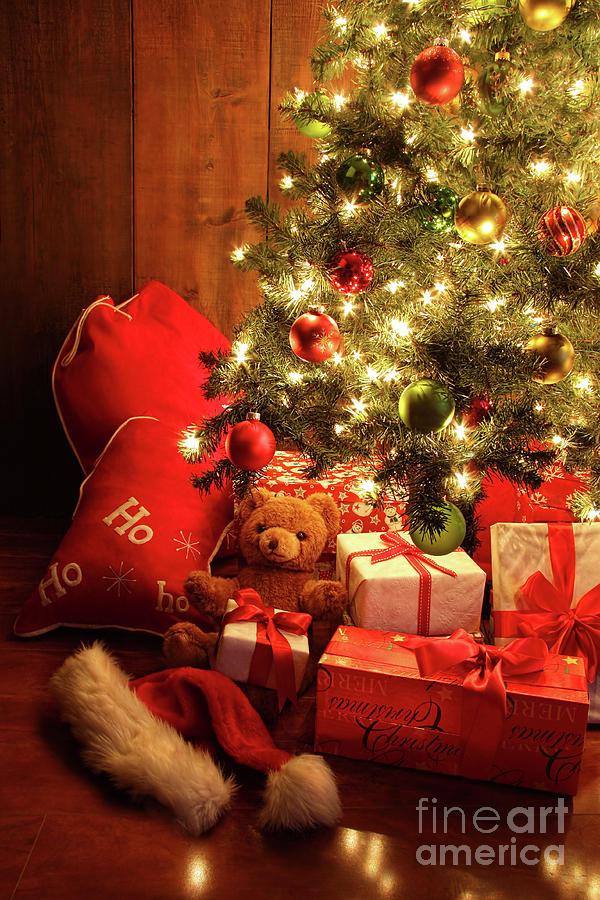 Brightly Lit Christmas Tree With Gifts Photograph