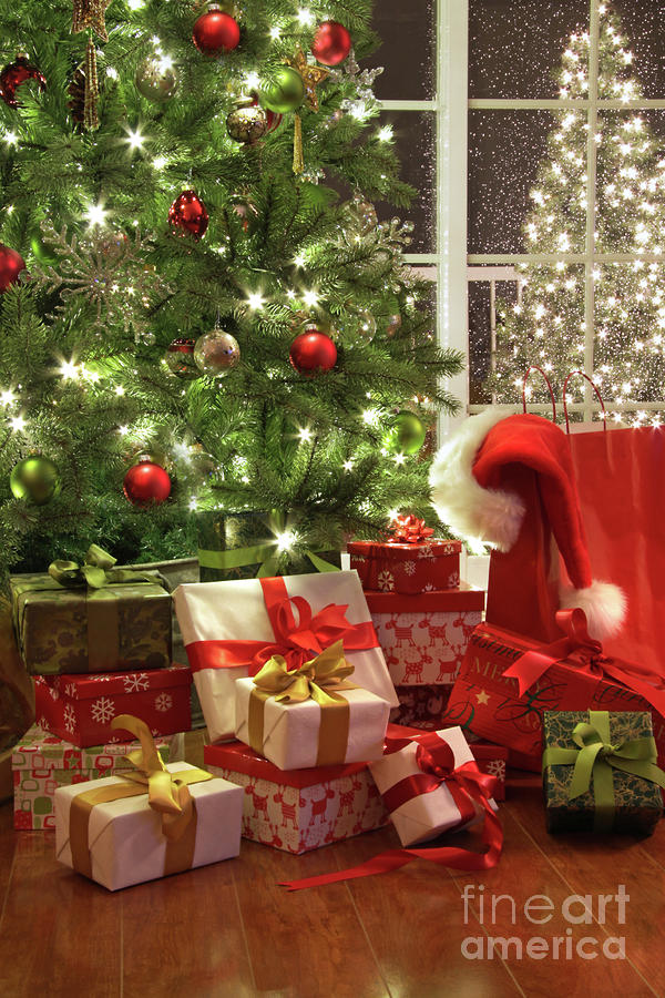 Brightly Lit Christmas Tree With Lots Of Gifts Photograph