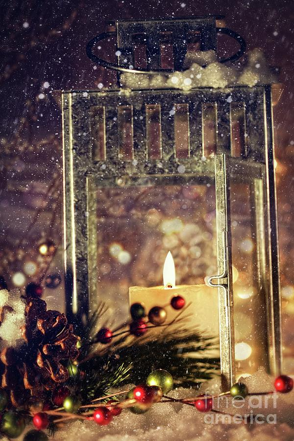 Background; Burn; Candle; Christmas; Cold; Color; Decoration; Evening; Fire; Glass; Holiday; Ice; Lamp; Lantern; Light; New; Night; Red; Season; Snow; Warm; Winter; Xmas; Year; Yellow; Santa; Claus; Snowy;  Photograph - Brightly Lit Lantern In The Snow by Sandra Cunningham