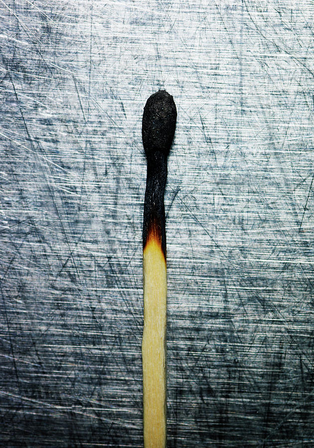 Burned Match On Stainless Steel. Photograph  - Burned Match On Stainless Steel. Fine Art Print