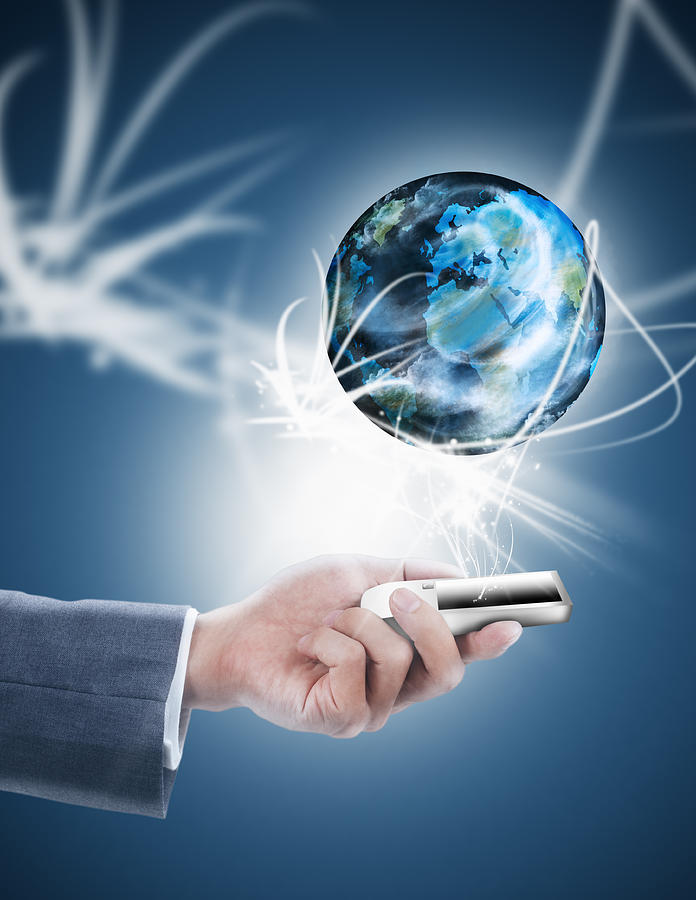 Businessman Holding Mobile Phone With Globe Photograph