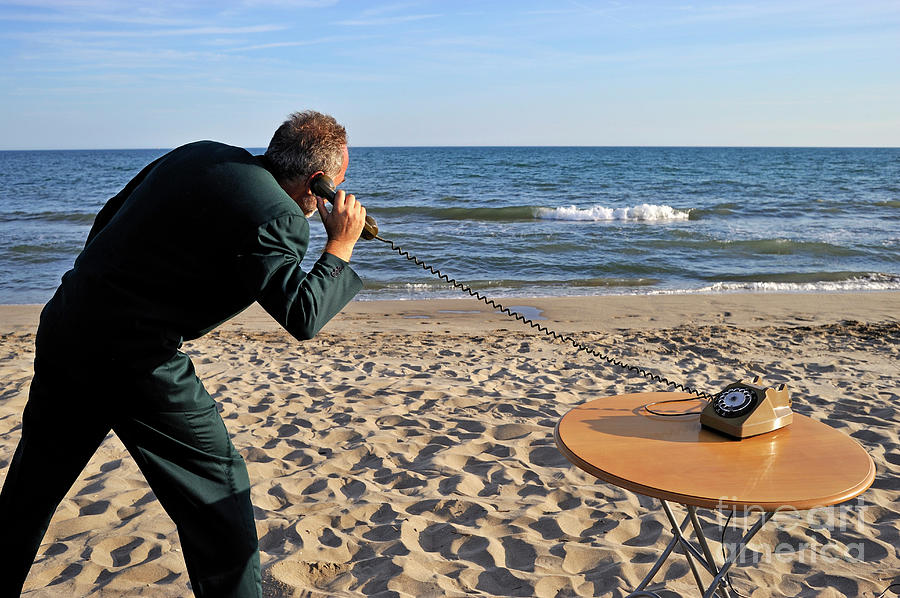 Businessman On Beach With Landline Phone Photograph