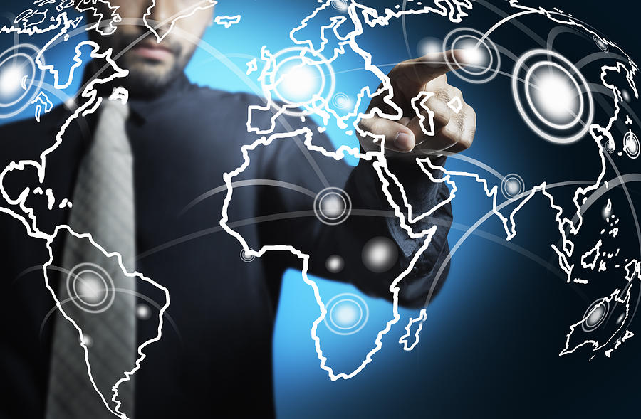 Businessman Touching World Map Screen Photograph