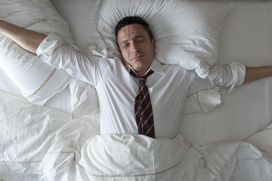 Businessman Waking Up With Clothes On Photograph