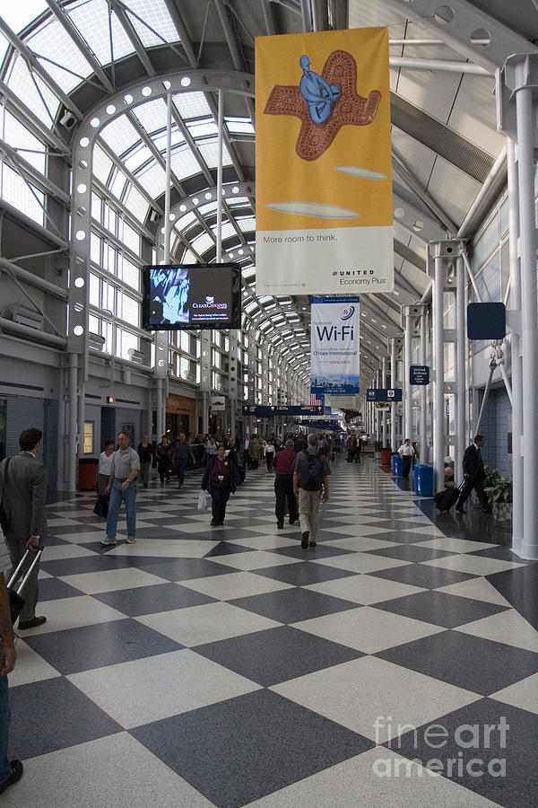 Vertical Photograph - Busy Airport Terminal Concourse At Chicagos Ohare Airport by Christopher Purcell