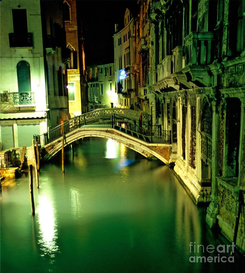 Canal And Bridge In Venice At Night Photograph