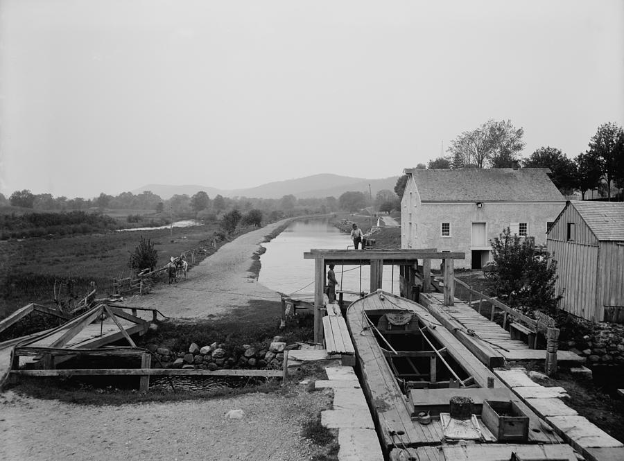 History Photograph - Canal Boat Passing Through A Lock by Everett