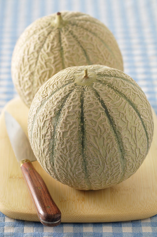 Vertical Photograph - Cantaloupes On Cutting Board by Jean-Christophe Riou