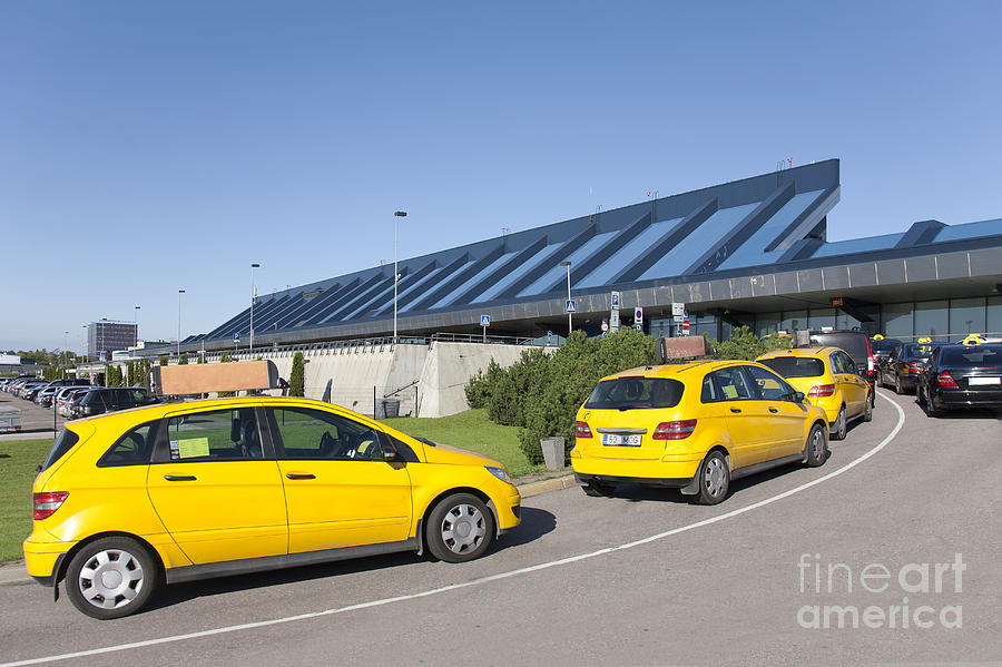 Air Travel Photograph - Cars Lining Up For Pickup At The Airport by Jaak Nilson