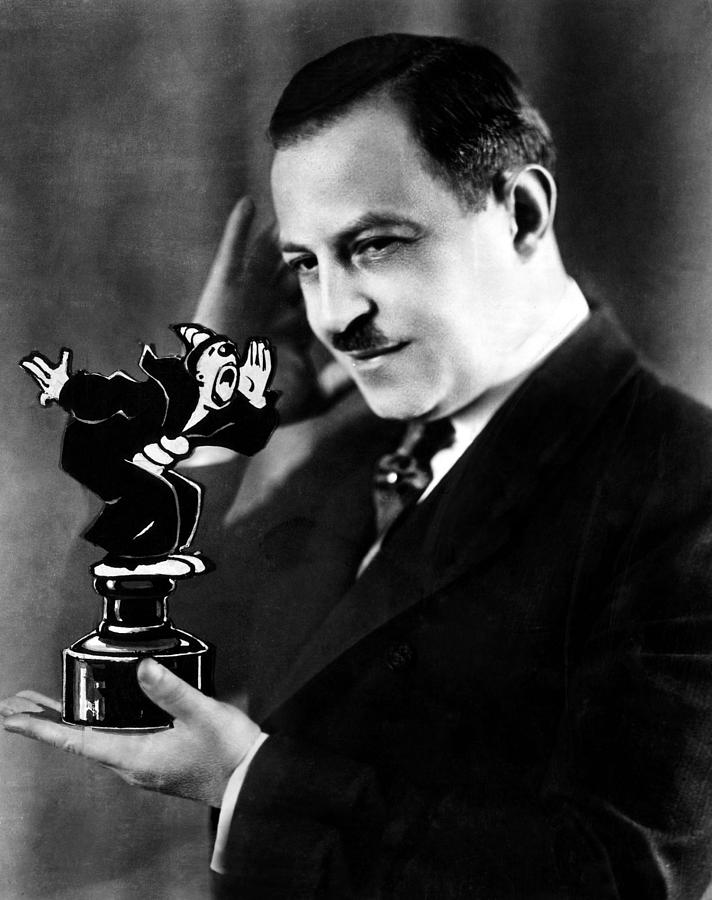 Cartoonist Max Fleisher Holding Photograph