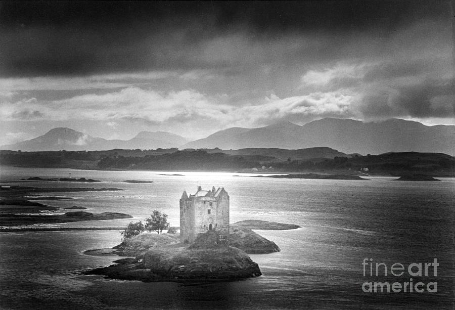 Medieval; Scottish; Landscape; Lake; Ominous; Foreboding; Brooding; Stormy Weather; Clouds; Dark; Mountains; Mountainous; Island; Exterior; Architecture; Gothic; Striking; Dramatic; Eerie; Mysterious; Mystery; Haunting; Haunted; Sinister; Spooky; Ghostly; Ethereal Photograph - Castle Stalker by Simon Marsden
