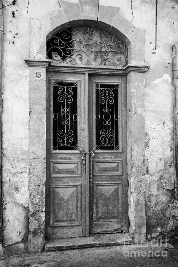chained up wooden door to derelict house near the restricted area of the UN buffer zone Photograph  - chained up wooden door to derelict house near the restricted area of the UN buffer zone Fine Art Print