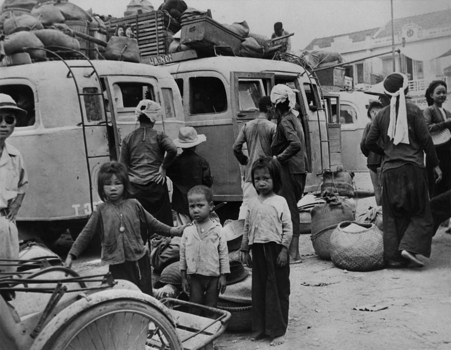 Children And Adults Evacuating Photograph