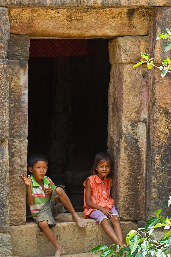 Children In The Doorway. Photograph
