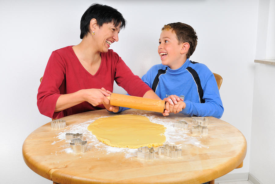 Christmas Baking - Mother And Son Laughing Photograph