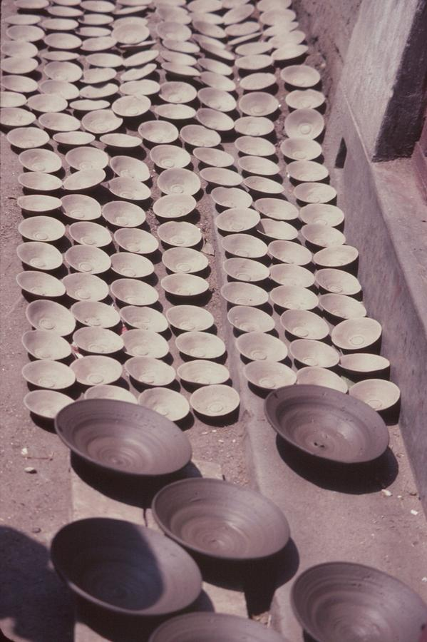 Clay Yogurt Cups Drying In The Sun Photograph