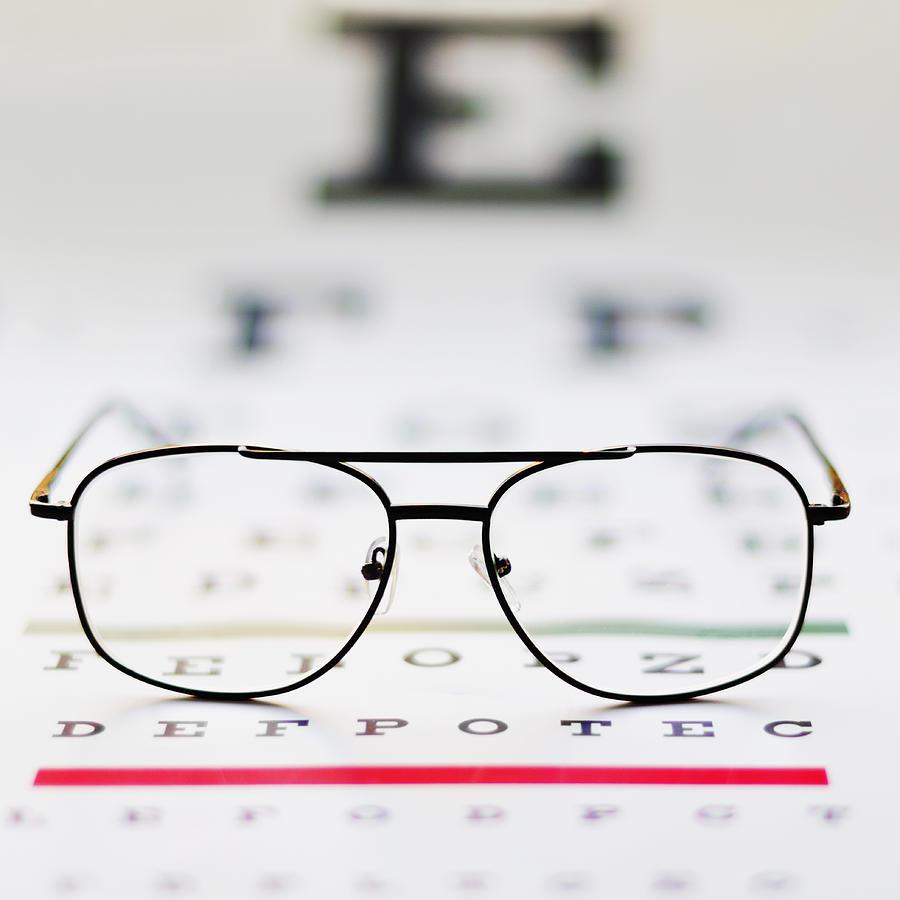 up of glasses on eye chart studio photograph
