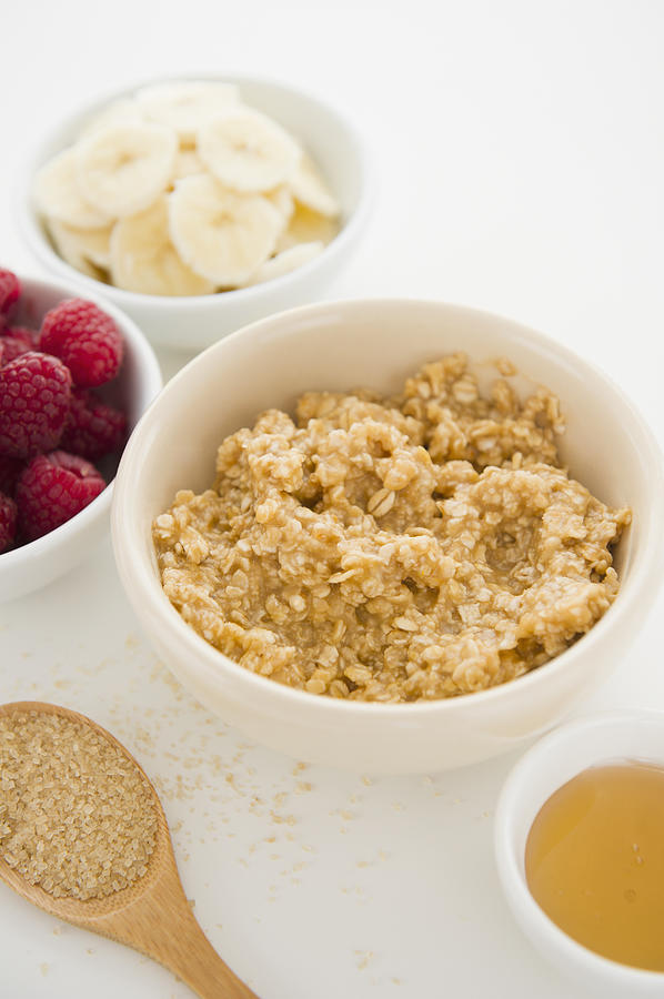 Close Up Of Oats And Fruits In Bowls, Studio Shot Photograph